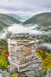 Fog rolls into the valley below Lindy Point on an autumn evening at Blackwater Falls State Park near Davis, West Virginia.