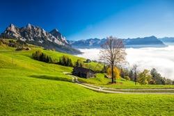 Fog surrounding Grosser, Kleiner Mythen, Lake Lucerne, Rigi mountain and Brunnen city from Sattel, Central Switzerland.