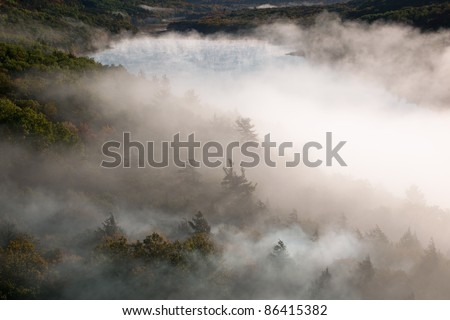 Foggy autumn landscape at sunrise, Lake of the Clouds, Porcupine Mountains Wilderness State Park, Michigan's Upper Peninsula, USA