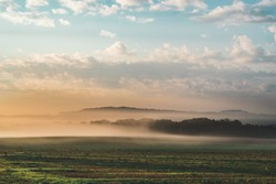 Foggy Early Morning Field landscape in the Countryside of France, Benney (Meurthe-et-Moselle) Beautiful Colored Sunset with Fog and Sea of Clouds Covering the Forest in Moody Atmosphere