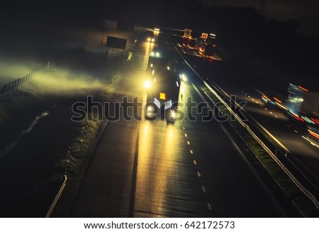 Foggy Highway Evening Commute Traffic. Motion Blur Long Exposure Concept. #642172573