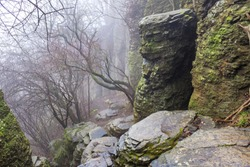 Foggy hike trail at Basalt organ pipes of Szent Gyorgy hill in Hungary in winter