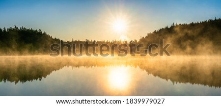 Foggy lake at sunrise in autumn. Swedish landscape Foto stock ©