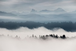 Foggy layered mountain landscape in Fort Langley, British Columbia, Canada