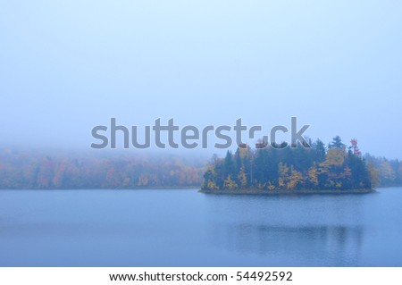 Foggy Misty island on a Vermont Lake