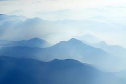 foggy morning in italian mountains - mountain range silhouttes