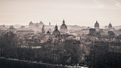 Foggy morning over the churches of Rome, Italy. Vintage background.