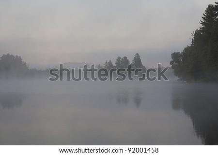 Foggy Muskoka lake at dawn