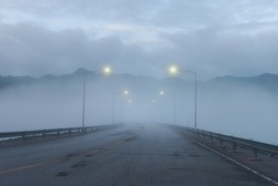 Foggy road on top of the dam