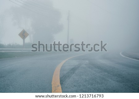 foggy rural asphalt highway perspective with white line, misty road, Road with traffic and heavy fog, bad weather driving Сток-фото ©