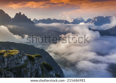 Foggy summer sunrise in the Italian Alps. Dolomites mountains, Italy, Europe.