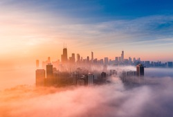 Foggy sunrise with Chicago skyline from a drone