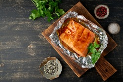 Foil pack dinner with fish. Fillet of salmon. Copy space. Healthy diet food, keto diet, Mediterranean cuisine. Oven-baked hot dinner. Top view, close up