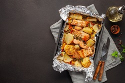 Foil pack dinners. Salmon with vegetables baked in foil. Dietary food. Top view