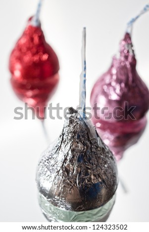 Foil Wrapped Chocolates with Valentine's Day Colours on Simple Background