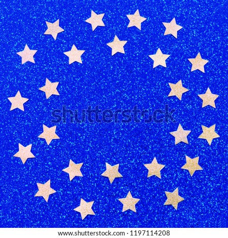foiled gold stars frame with stars scattered stars border on blue background natural