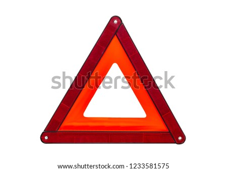 Foldaway, reflective road hazard warning triangle isolated on a white background with a clipping path. #1233581575