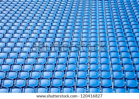 Folded blue plastic chairs on a temporary  tribune