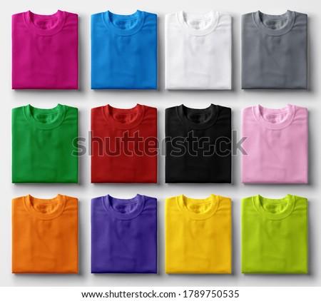 Folded colorful t-shirts on white background. Photo stock ©