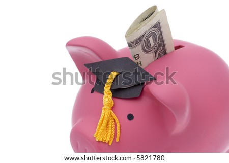 Folded dollar bill being inserted into bank wearing graduation hat