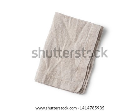Folded gray linen napkin isolated on white background. Natural light gray linen napkin. Isolated on white with clipping path. Top view or flat lay.