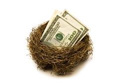 Folded hundred dollar bills put away for retirement.  Everyone needs a little nest egg.