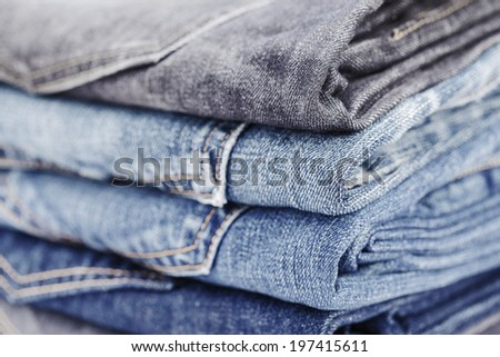 folded jean stack close up