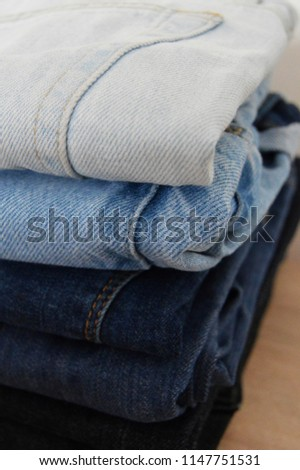Folded jeans, shades of blue  #1147751531