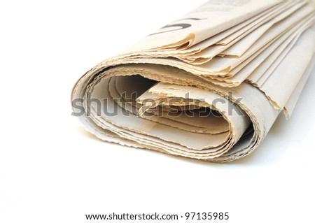 Folded newspaper on white background