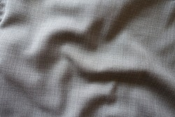 Folded simple grey fabric with dupplins checks
