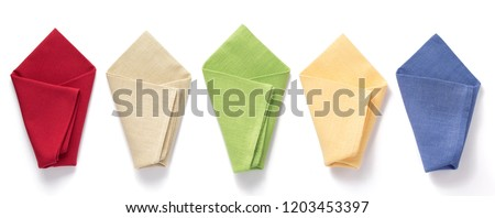 folded table cloth napkin at white background, top view