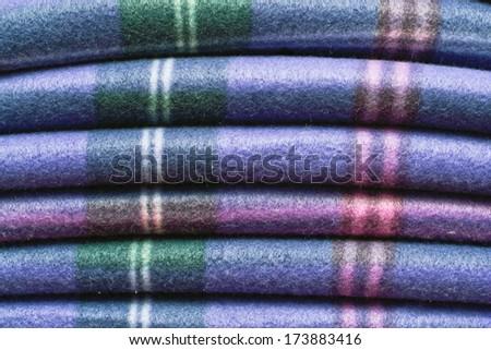 Folded tartan blanket as a background image