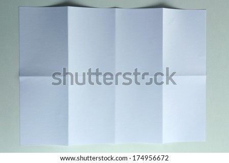 Folded white sheet of paper close up