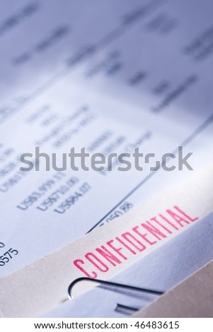 """Folder labeled """"confidential"""" on top of some business documents."""