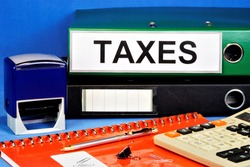Folder labeled Taxes — mandatory gratuitous payment levied from organizations and individuals.