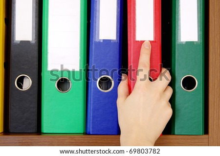 Folder with archival documents and a hand