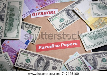 Folder with Paradise papers label on it with european and american currency, offshore tax heaven documents leak concept #749496100