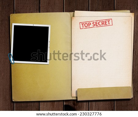 folder with TOP SECRET stamped across the front page and a blank photograph  Stock photo ©
