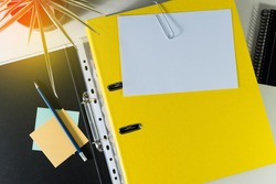Folder with white paper for notes, and office supplies, on desk. Concept of education.
