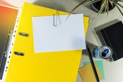 Folder with white paper for notes, and office supplies, soda can, note book, on desk. Concept of education.