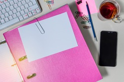 Folder with white paper for notes, and office supplies, Tea cup, mobile phone, on desk. Concept of education.