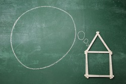 folderable ruler form a house shape with thinking bubble