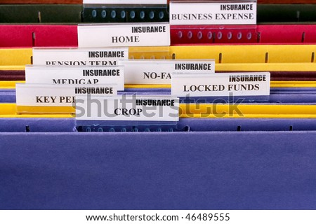Folders for documents at office of the insurance company with Crop.