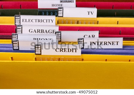 Folders in which are stored documents with bills and the information under credits.