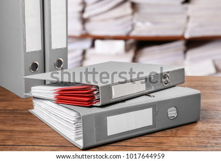 Folders with documents on table in archive #1017644959