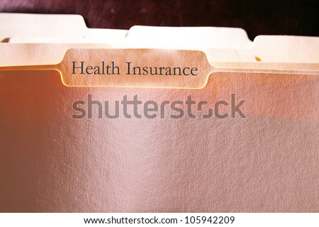 folders with Health Insurance text