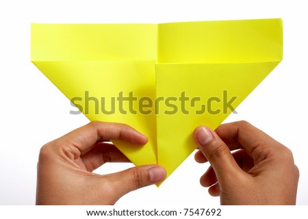 folding a piece of paper over a white background #7547692