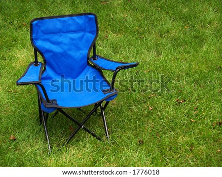 folding blue camp chair on the lawn