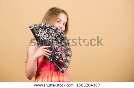 Folding fans. Acting school. Dances with fan. Girl fanning herself with fan. Air circulation. Art and culture. Handheld fan create airflow. Airflow from handfans increases evaporation. Cooling effect. #1503284369
