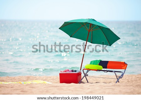 folding furniture and ice box on summer beach